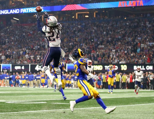 New England Patriots cornerback Stephon Gilmore (24) intercepts a pass intended for Los Angeles Rams wide receiver Brandin Cooks (12) late in the fourth quarter of Super Bowl LIII.