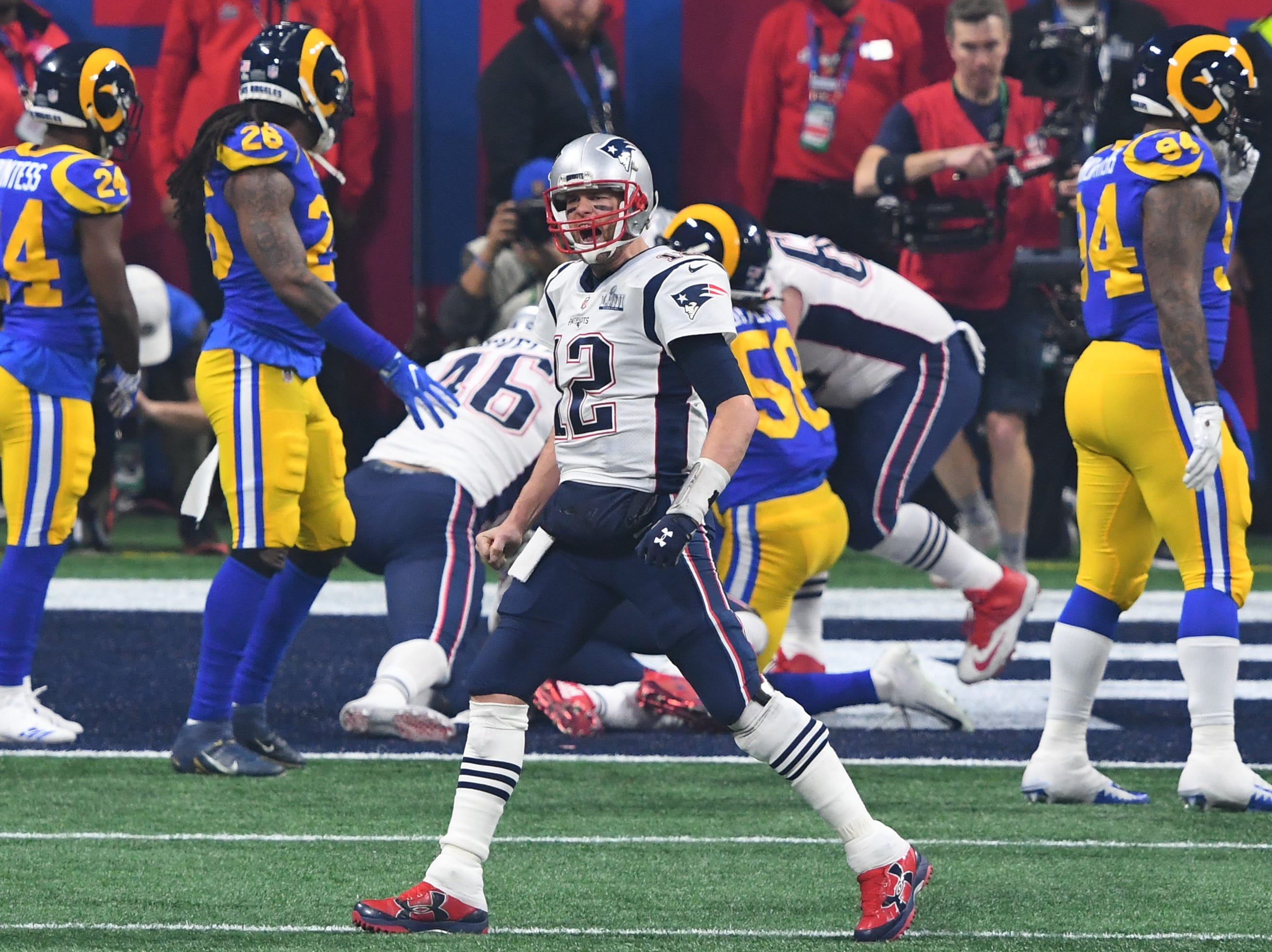 Quarterback Tom Brady (12) celebrates after the Patriots score a rushing touchdown during the fourth quarter of Super Bowl LIII.