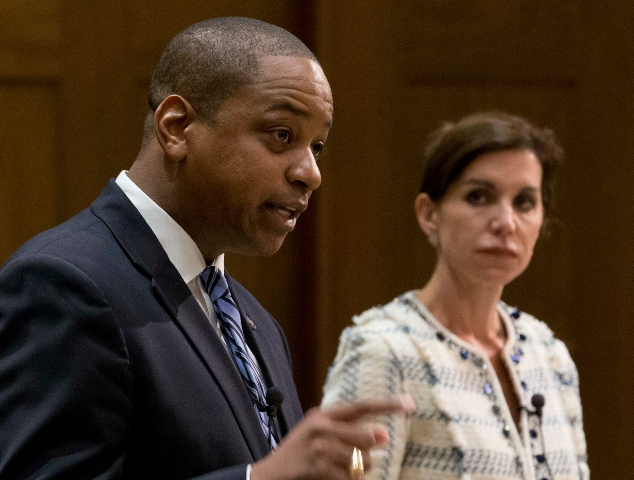 Democratic candidate for Lt. Gov. Justin Fairfax, gestures during a debate with Republican Virginia State Sen. Jill Vogel, right, at the University of Richmond in Richmond, Va., Thursday, Oct. 5, 2017. (AP Photo/Steve Helber)