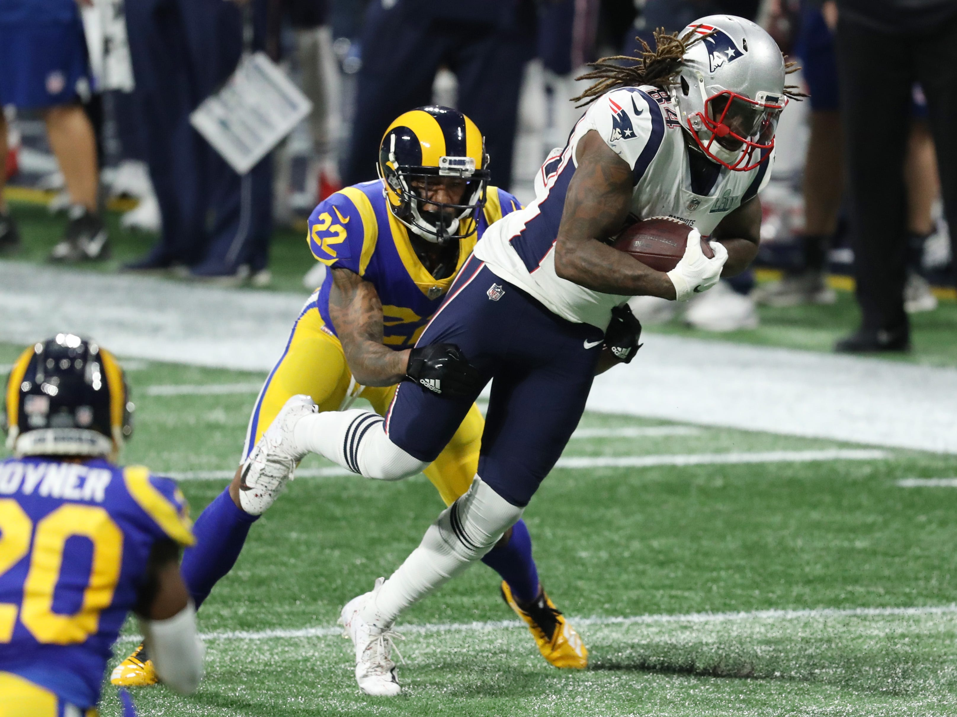 New England Patriots wide receiver Cordarrelle Patterson (84) tries to break the tackle Los Angeles Rams cornerback Marcus Peters (22) during the second quarter of Super Bowl LIII at Mercedes-Benz Stadium.