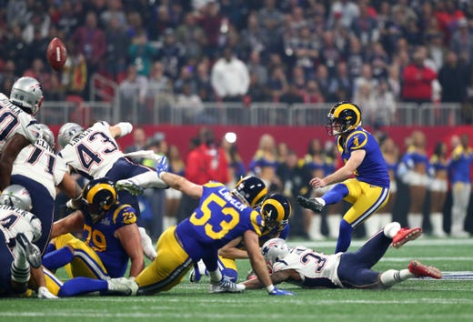 Los Angeles Rams kicker Greg Zuerlein (4) kicks a 53-yard field goal in the third quarter of Super Bowl LIII at Mercedes-Benz Stadium.