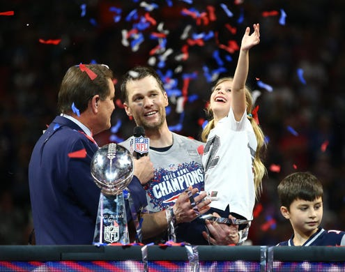 Quarterback Tom Brady and his daughter Vivian celebrate as they are interviewed by CBS host Jim Nantz after the Patriots' 13-3 win over the Rams in Super Bowl LIII.