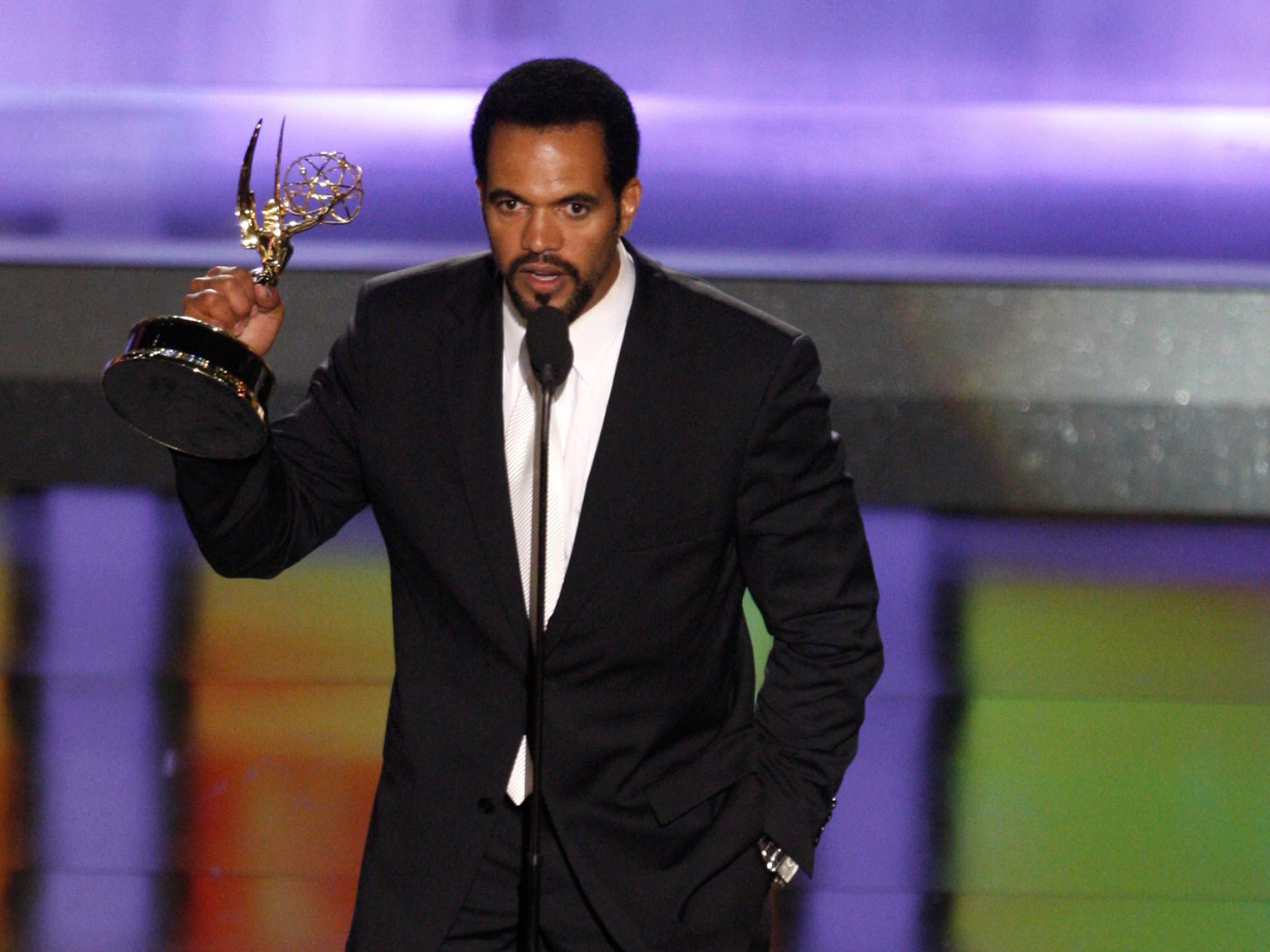"Kristoff St. John accepts the award for outstanding supporting actor in a drama series for his work on ""The Young and the Restless"" at the 35th Annual Daytime Emmy Awards in Los Angeles,  June 20, 2008."