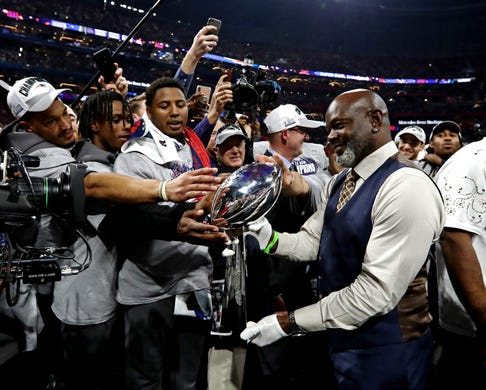 Pro Football Hall of Famer and former NFL running back Emmitt Smith brings the Vince Lombardi Trophy to the stage at Mercedes-Benz Stadium.
