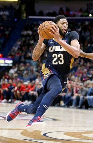 Anthony Davis is interested in a trade to four teams, USA TODAY Sports has learned.