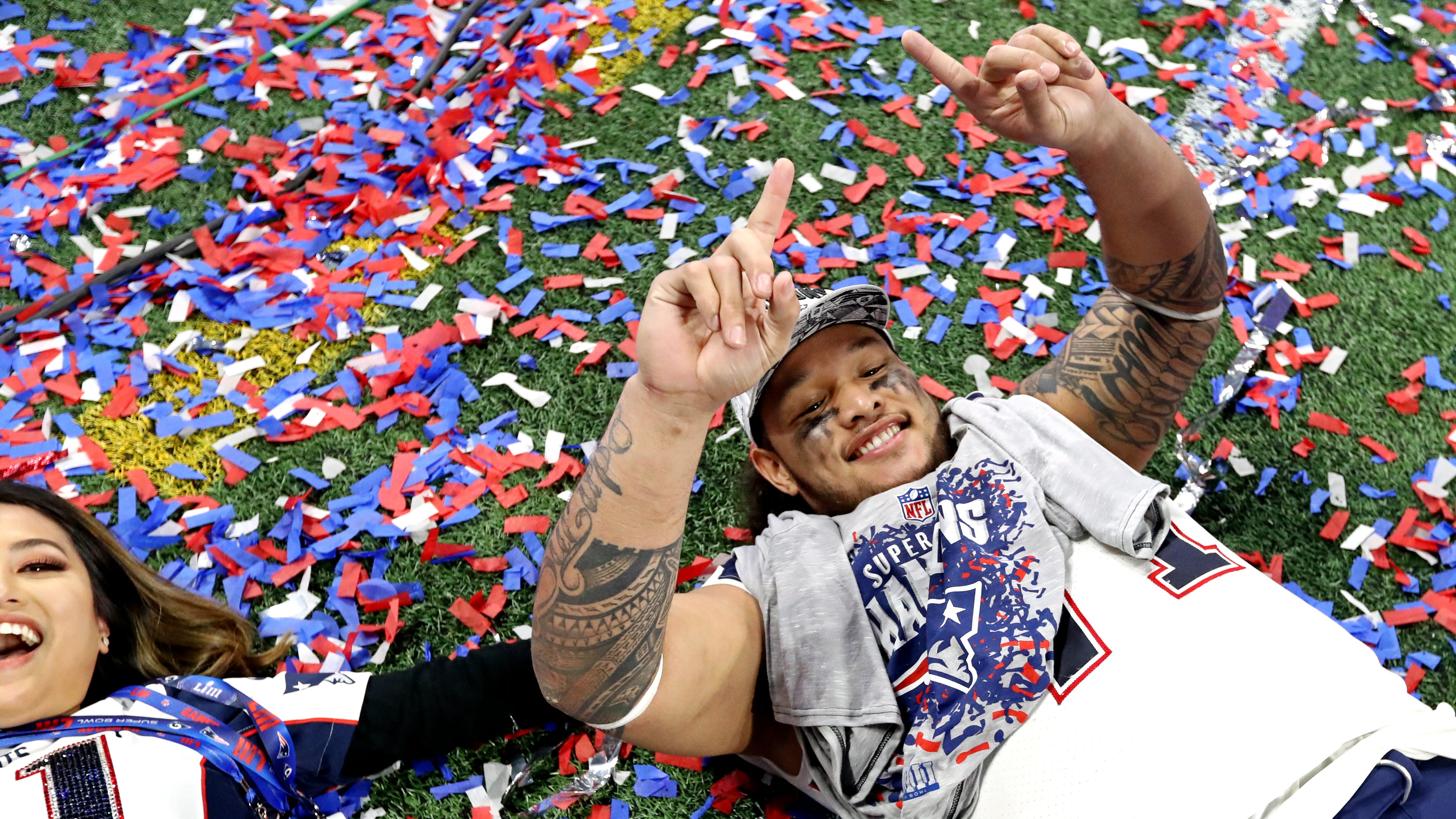 New England Patriots defensive tackle Danny Shelton (71) celebrates with his wife Mara Shelton after beating the Los Angeles Rams in Super Bowl LIII at Mercedes-Benz Stadium.