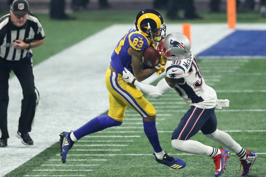 Los Angeles Rams wide receiver Josh Reynolds (83) catches a pass against New England Patriots cornerback Jason McCourty (30) during the third quarter of Super Bowl LIII.