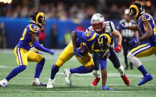 Los Angeles Rams inside linebacker Cory Littleton (58) intercepts a pass intended by New England Patriots wide receiver Chris Hogan (15) during the first quarter of Super Bowl LIII.