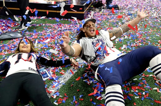 Defensive tackle Danny Shelton (71) celebrates with his wife Mara Shelton after the New England Patriots beat the Los Angeles Rams in Super Bowl LIII.