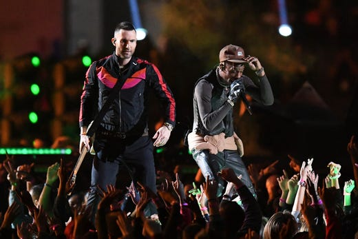 Recording artist Travis Scott, right, performs with Maroon 5 during the Super Bowl LIII halftime show at Mercedes-Benz Stadium.