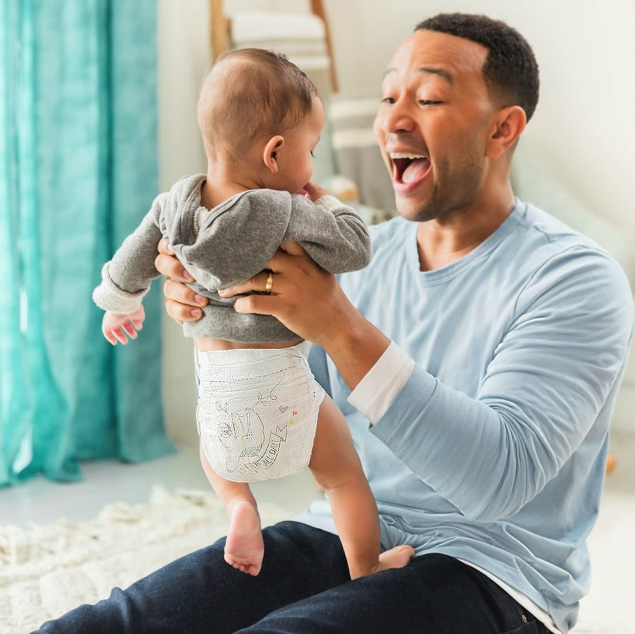 John Legend appears with his son Miles, daughter Luna and wife Chrissy Teigen in Pamper's Super Bowl commercial.