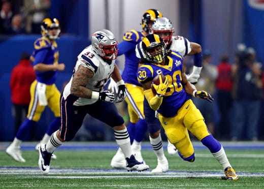 Los Angeles Rams running back Todd Gurley (30) runs the ball against New England Patriots defensive tackle Lawrence Guy (93) during the third quarter of Super Bowl LIII.
