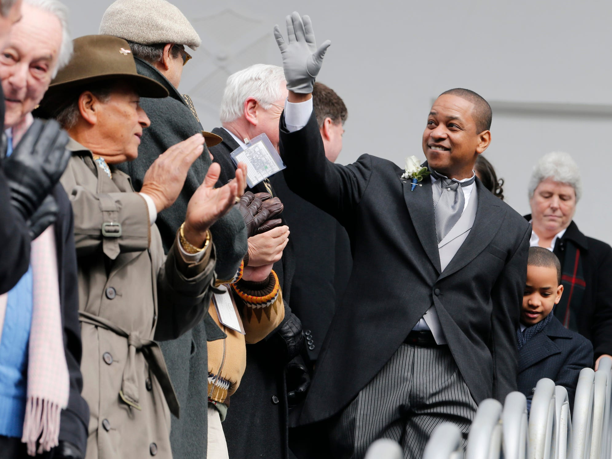 Virginia Lt. Gov. Justin Fairfax waves to the crowd as he arrives for inaugural ceremonies at the Capitol in Richmond, Va., Saturday, Jan. 13, 2018. (AP Photo/Steve Helber)