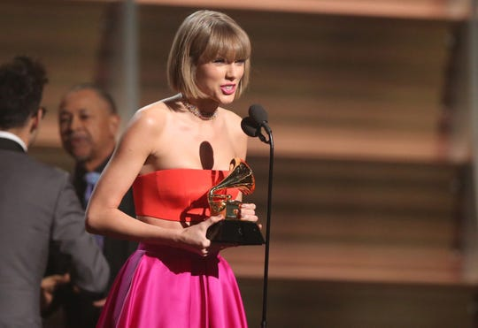 Taylor Swift accepting the album of the year trophy for '1989' in 2016.