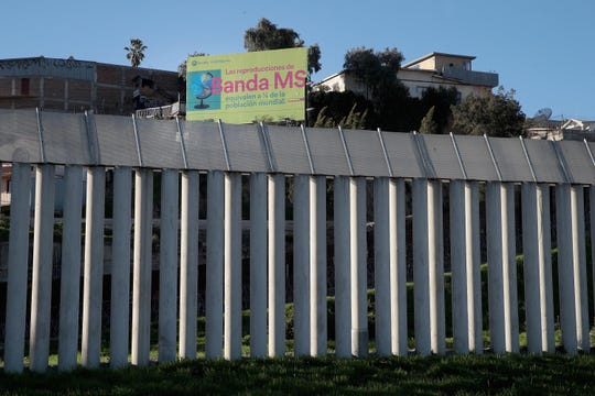A concrete wall provides a barrier between the United States and Mexico  in San Diego, California.