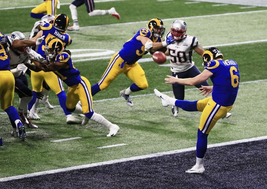 The Rams' Johnny Hekker punts out of the end zone in the second quarter of Super Bowl LIII.