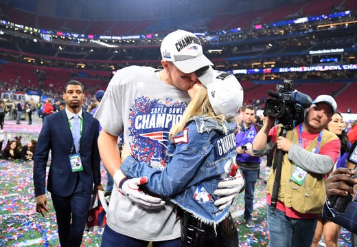 Tight end Rob Gronkowski gets a kiss from girlfriend Camille Kostek after the Patriots beat the Rams 13-3 in Super Bowl LIII.