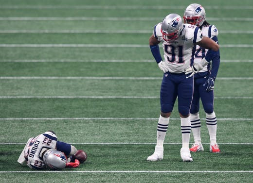 New England Patriots defensive end Deatrich Wise (91) looks on as strong safety Patrick Chung (23) lays on the field after suffering an apparent arm  injury during the third quarter of Super Bowl LIII.