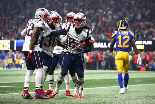 New England Patriots cornerback Stephon Gilmore (24) celebrates with teammates after intercepting a pass to thwart a Rams rally late in the fourth quarter of Super Bowl LIII.