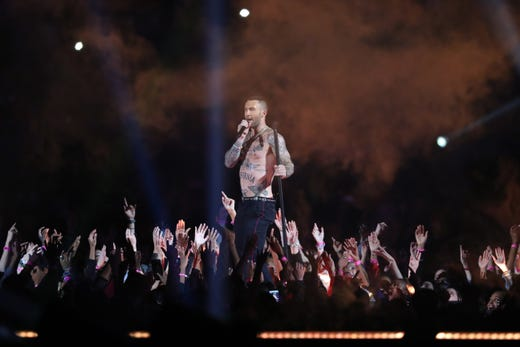 Lead singer Adam Levine and Maroon 5 perform during the halftime show at Super Bowl LIII at Mercedes-Benz Stadium.