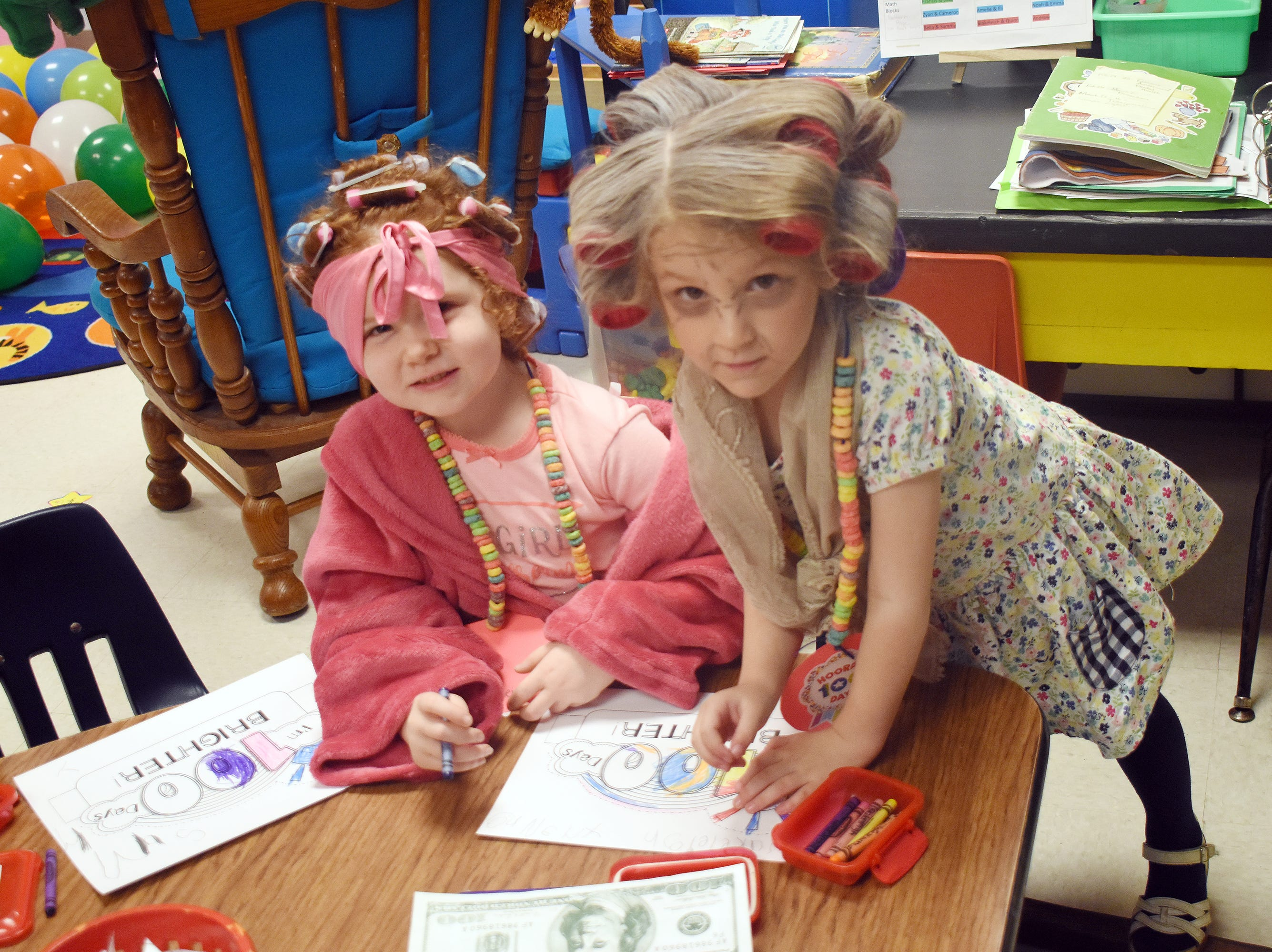 St. Frances Cabrini pre-Kindergarten students Blakeleigh Nugent (left) an Morgan Delaney complete classwork marking 100 days of School as they are dressed as 100-year-olds. On Tuesday, Feb. 5, 2019, St. Frances Cabrini School pre-Kindergarten and Kindergarten students dressed up as 100-year-olds in celebration of 100 days of school.