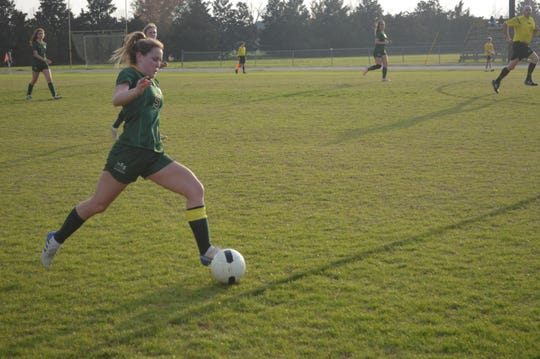 Menard senior Emily Carbo winds up to kick the ball against Cabrini Monday.