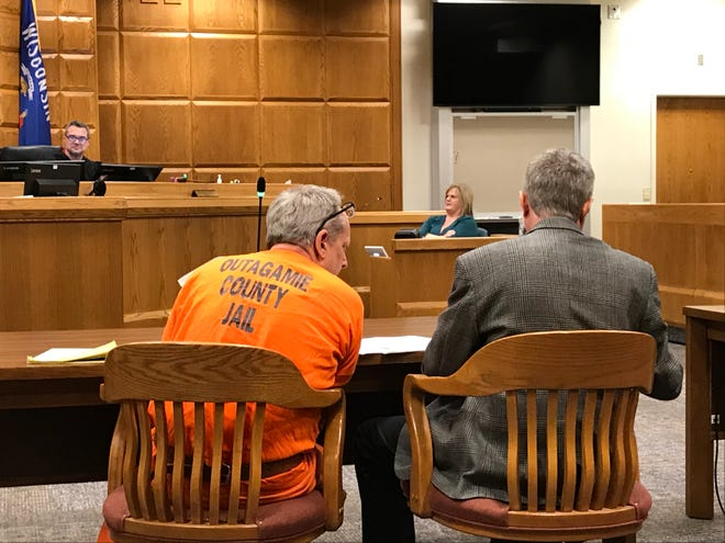 Michael Witzke confers with his attorney Kevin Musolf in Judge Gregory B. Gill Jr.'s courtroom Tuesday.