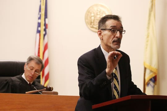 New Jersey Deputy Attorney General John A. Nicodemo makes his opening statements during the first day of the trial for Rabbi Osher Eisemann, founder of Lakewood's School for Children with Hidden Intelligence, who is charged with using nearly $1 million public dollars for his personal interests, before Judge Benjamin Bucca at the Middlesex County Courthouse in New Brunswick, NJ Tuesday, February 5, 2019.