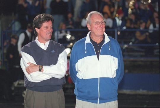 Former Donovan Catholic basketball coach Steve Gepp (right) with Kevin Billerman, who scored 1,742 points playing for Gepp, on the sideline at a Donovan Catholic football game in 2001.
