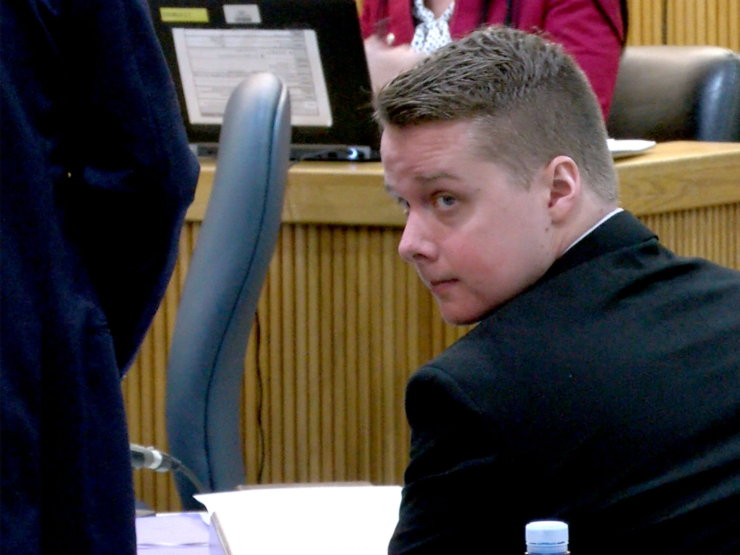 Liam McAtasney looks over his shoulder to  his family in State Superior Court in Freehold Tuesday, February 5, 2019.  He is on trial for the murder of Sarah Stern.