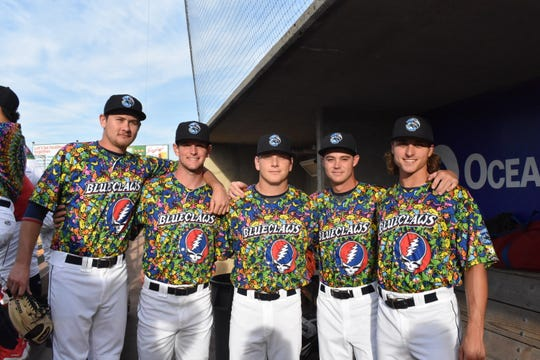 Lakewood BlueClaws players seen wearing the custom jerseys for 2018's Grateful Dead night.
