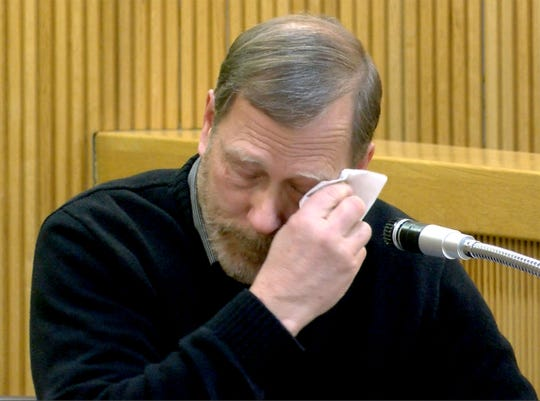 Michael Stern wipes away tears as he testifies about his daughter Sarah Stern in State Superior Court in Freehold Tuesday, February 5, 2019.  Liam McAtasney is on trial for the murder of Sarah Stern.