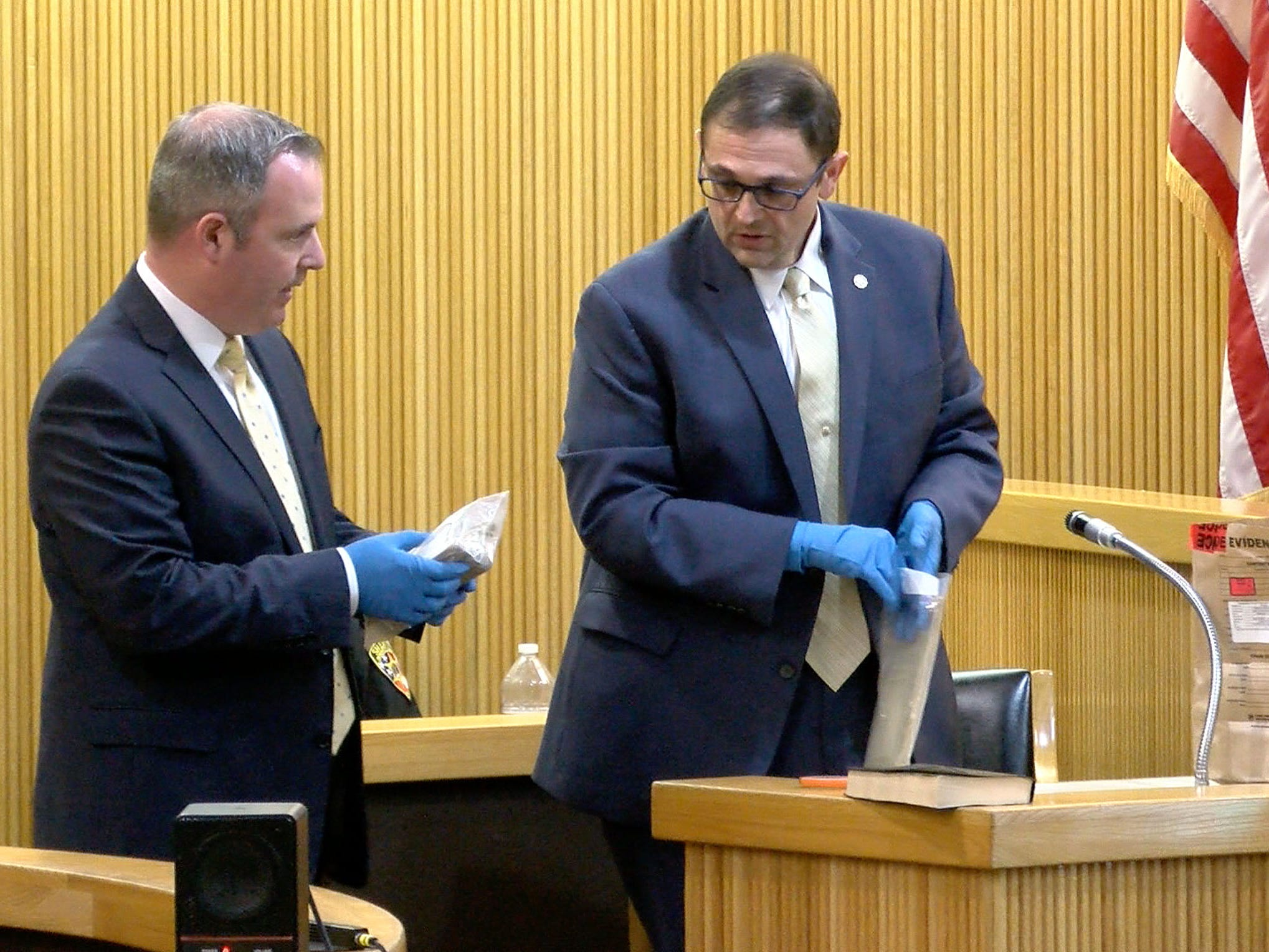 Monmouth County Assistant Prosecutor Chris Decker (left) and Prosecutors office Detective Nicholas Cattelona hold the $25,250 in cash that was found in Sarah Stern's safe deposit box in State Superior Court in Freehold Tuesday, February 5, 2019.  Liam McAtasney is on trial for the murder of Sarah Stern.