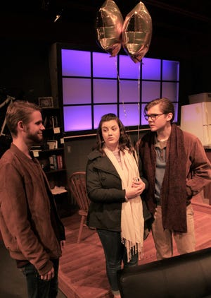 """James Dodd (senior Robert Taylor, left) meets friends Richard Ehrlich (freshman Trey Smith) and his girlfriend Mandy Bloom (sophomore Maddie Murgia) in Dodd's New York City apartment in this rehearsal scene from Hardin-Simmons University's production of """"Time Stands Still."""""""
