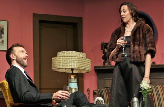 """After beginning """"Same Time, Next Year"""" in a state of undress, George (Keith May) and Doris (Amanda Keith) are all dressed  up for their reunion a few years later in this rehearsal scene from Abilene Community Theatre's presentation of the romantic comedy-drama."""
