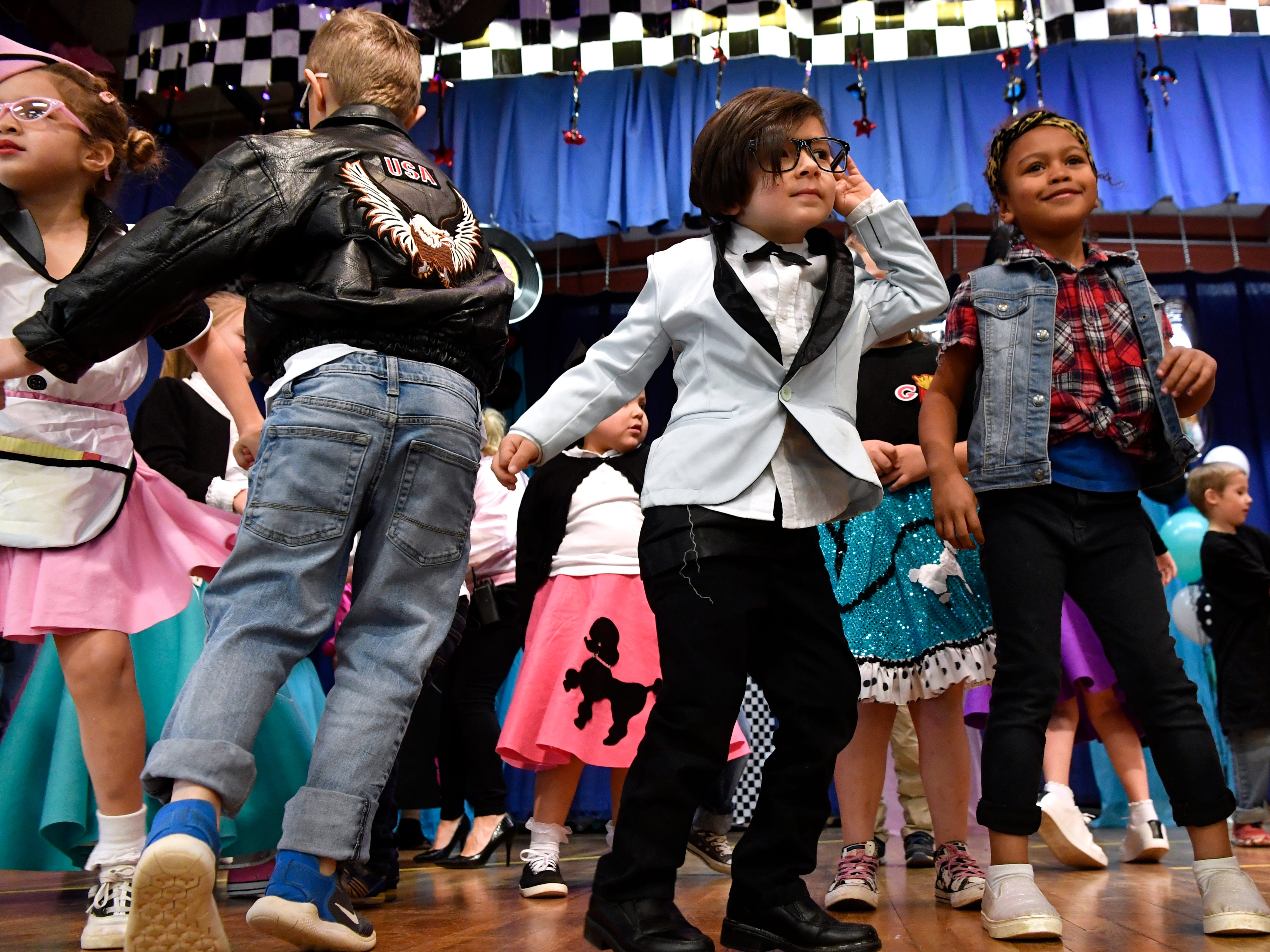 Kindergartner A.J. Rodgriquez cups a hand to an ear as he dances the twist with Evee Mason Jan. 25, 2019. Austin Elementary School students from all grades performed the Twist, the Stroll, and the Hand Jive for family and friends.