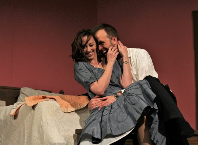"George (Keith May) cuddles Doris (Amanda Keith) the morning after they begin a long affair and vow to meet the ""Same Time, Next Year."" It's the new Abilene Community Theatre production."