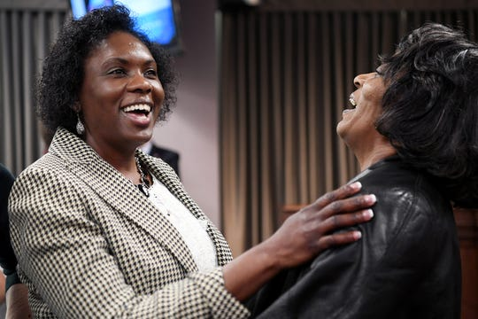 Avril Pinder, left, laughs as she speaks with Johnnie Grant after she was unanimously voted to become Buncombe County's next county manager Tuesday, Feb. 5, 2019, after a roughly six-month search. Pinder will be the first person of color to hold the position and the fourth person to serve as county manager in less than two years.