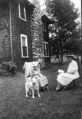 Mary Whitton, holding a letter, possibly from her son, converses with Lucy Holmes in front of the home Holmes had built in Beech in 1918. The dog belonged to both and was named Rip.