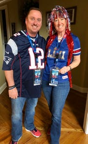Asheville residents Rob and Jeanne Poulin sport Patriots regalia and two Super Bowl LIII passes before the big game Sunday.