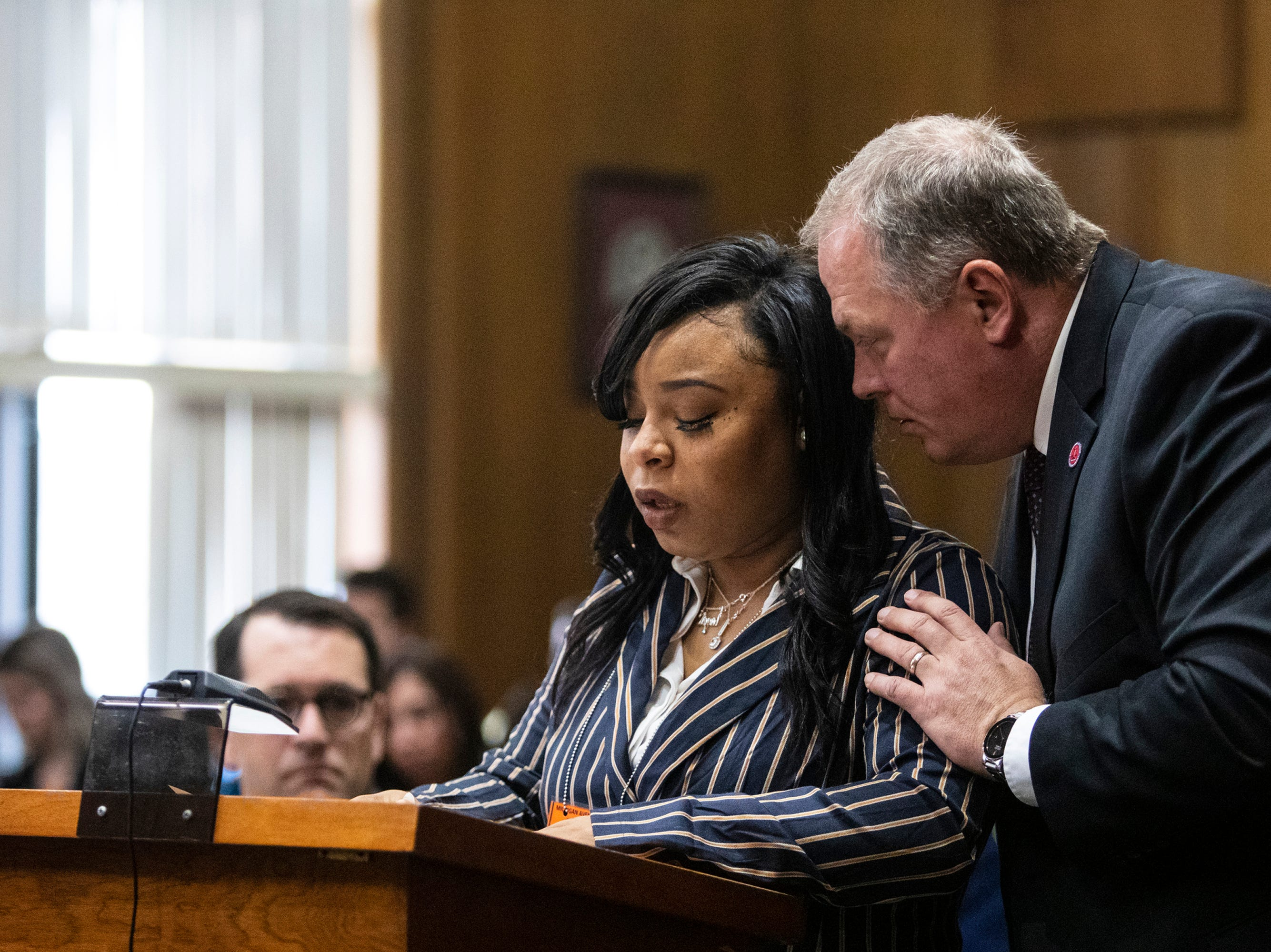 Kalamazoo County Prosecutor Jeff Getting whispers to Tiana Carruthers as she addresses Jason Dalton before he is sentenced to life in prison without possibility of parole for six counts of murder and several other charges at the Kalamazoo County Courthouse in Kalamazoo, Michigan on Tuesday, Feb. 5, 2019.