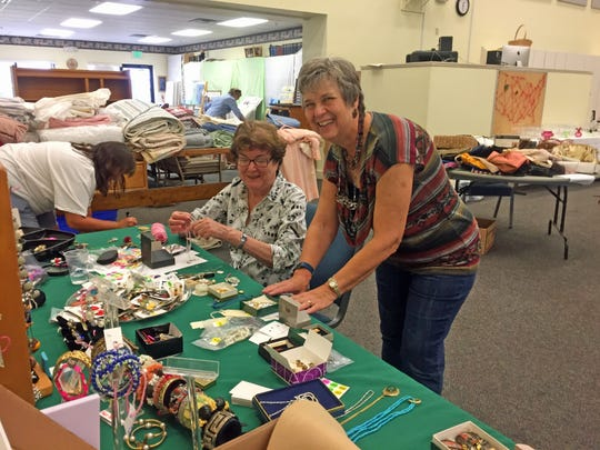 "Carlene ""CC"" Bowden (seated) and Anne Adams get things ready for the AWESOME Rummage Sale at Eastminster Presbyterian Church in Indialantic on Feb. 16."