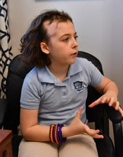 Jenna Gathercole, a 9-year-old fourth-grader at Viera Charter School, has Alopecia, an auto-immune disease that causes hair loss. After a bullying incident at the school, the teachers helped her develop a program to educate her classmates about her situation. On Tuesday, Feb. 5, 2019, she gave a PowerPoint presentation to the students during lunch, and her classmates took an anti-bullying pledge.