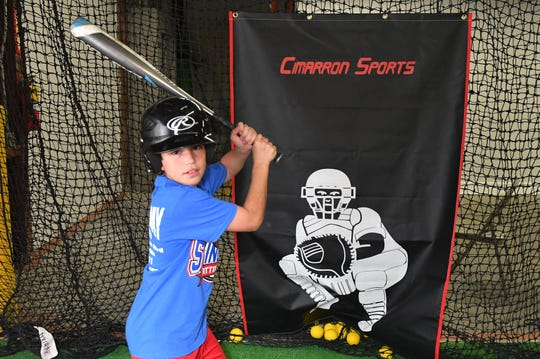 Deklyn Tynan, 10, at the new Swing Away Batting Cages, located at 600E John Rodes Blvd. in Melbourne. The grand opening is Feb. 9. The 7,500 square foot indoor facility is fully air conditioned, and includes batting cages, pitching mounds and a lounge.