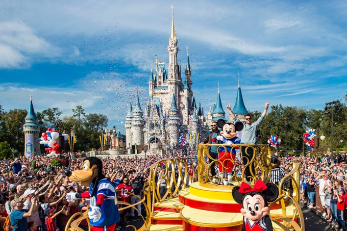 New England Patriots wide receiver Julian Edelman (left) and quarterback Tom Brady (right) celebrated their Super Bowl LIII victory Monday, Feb. 4, 2019, at Walt Disney World Resort. The pair participated in a parade with Mickey Mouse and other Disney pals, waving to cheering fans as they traveled down Main Street, U.S.A. at Magic Kingdom Park.
