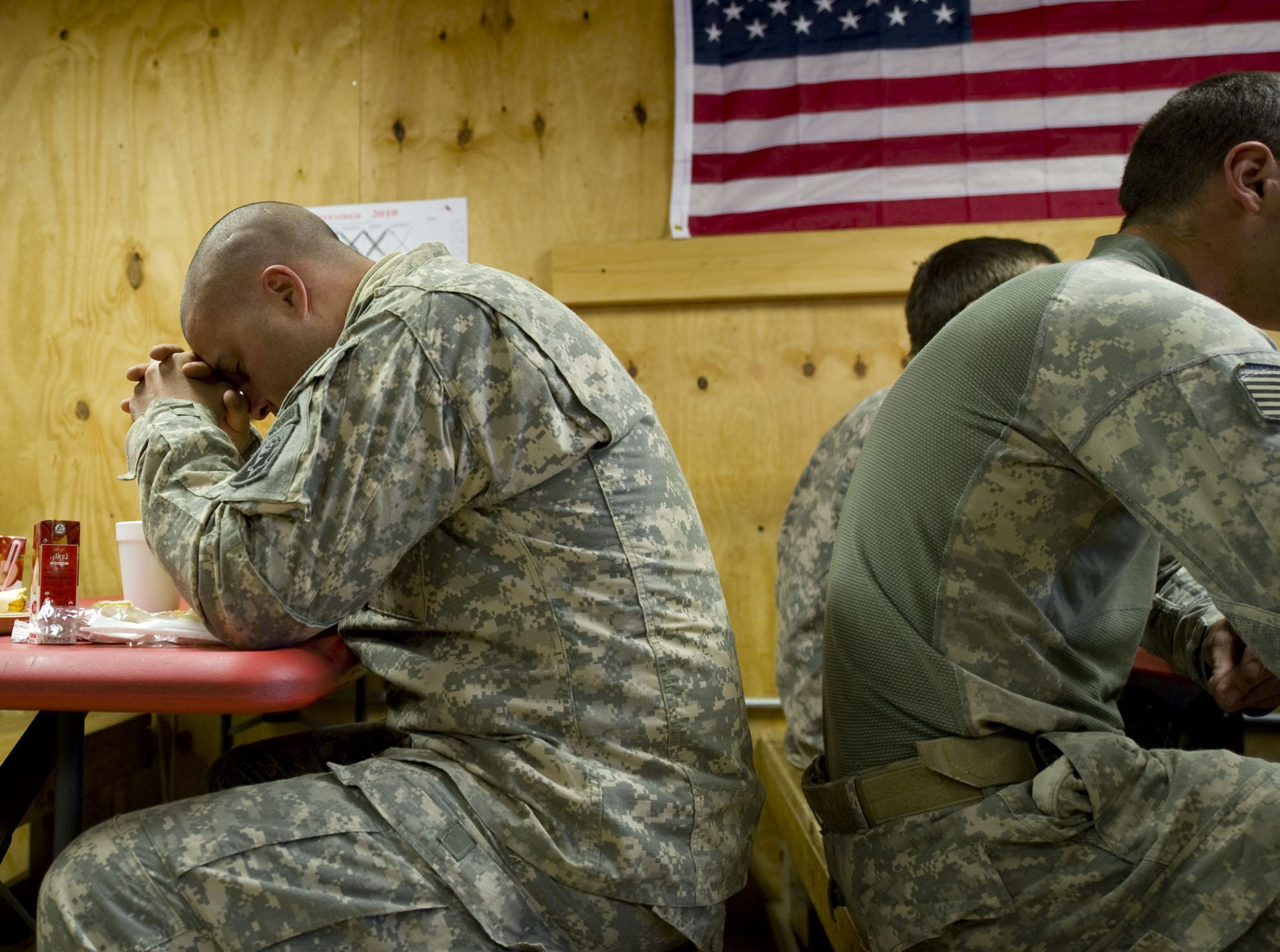 Sgt. Jesse Garcia of Sacramento, Calif., takes a moment for prayer before breakfast at Combat Outpost Herrera on Tuesday morning, September 21, 2010. A month earlier, two Vermont National Guard soldiers, Sgt. Tristan H. Southworth, 21, of Walden, Vt., and Sgt. Steven J. Deluzio, 25, of South Glastonbury, Conn., were killed by insurgents during a mission in a remote part of Paktia province just miles from the border with Pakistan.