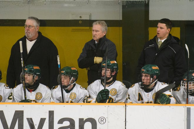 Assistant coach Bill O'Neil, center, and the  BFA-St. Albans bench watch the action on the ice during the boys hockey game between the Essex Hornets and the BFA-St. Albans Bobwhites at the Collins Perley sports complex on Monday night Feb. 4 in St. Albans.