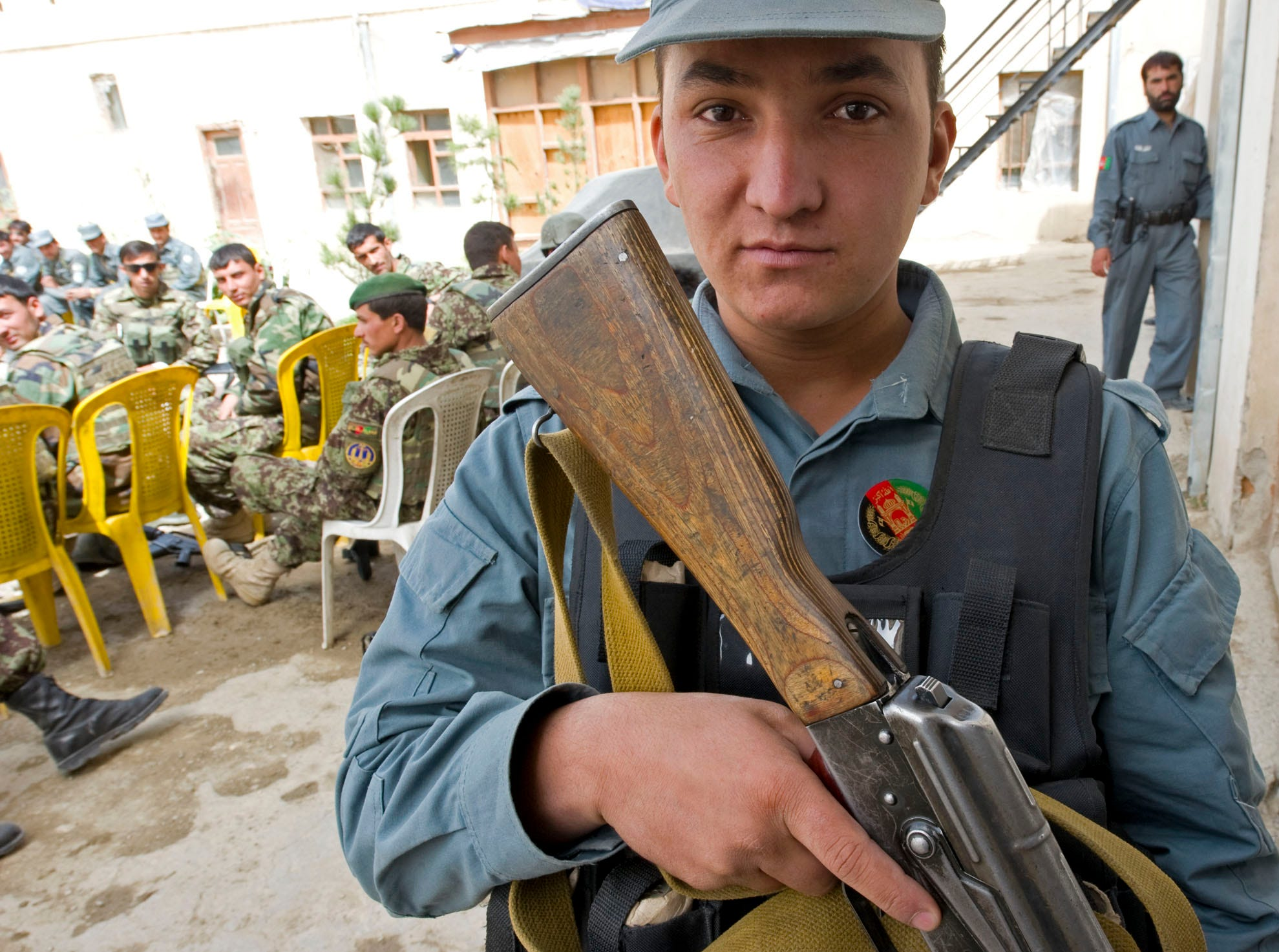 Rahmatullah, a Afghan Uniform Police officer with a rapid-response contingent of the Afghan National Army, waits at a police station in Gardez City on Saturday, September 18, 2010, during Afghanistan's national elections. Afghan Uniform Police along with Border Patrol and Afghan National Army soldiers provided heavy security in and around polling areas in the city.