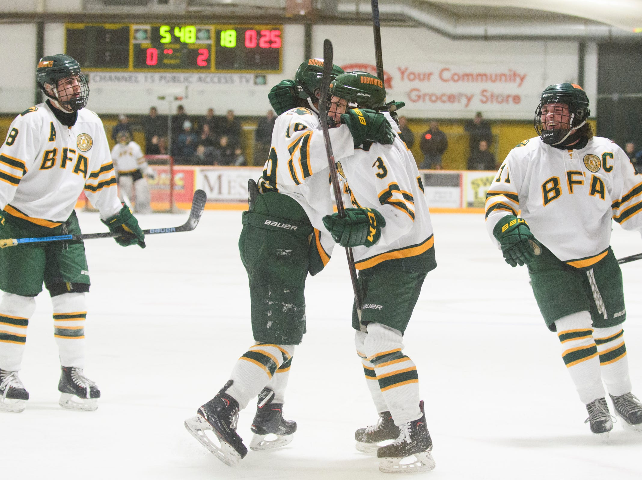 BFA celebrates a goal during the boys hockey game between the Essex Hornets and the BFA St. Albans Bobwhites at the Collins Perley sports complex on Monday night February 4, 2019 in St. Albans, Vermont.