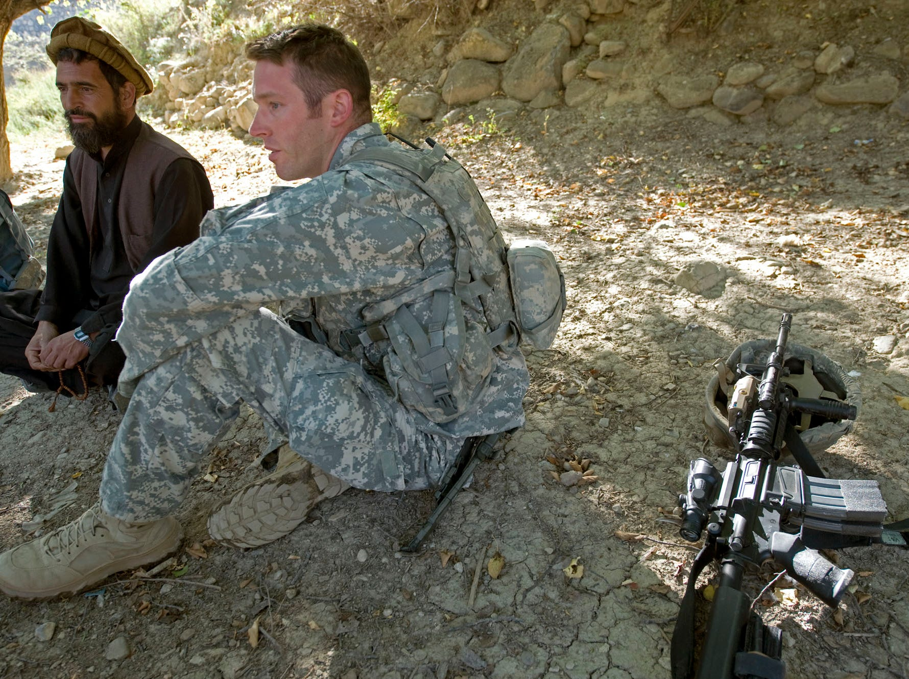 Vermont National Guard Sgt. 1st Class Jay Pedro of Woodstock, Vt., talks with a villager in Kuzah Shegah on Tuesday morning, September 21, 2010, looking for information about insurgent activity in the area. A spotter was seen in the village as Combat Outpost Herrera was being attacked by mortar fire.